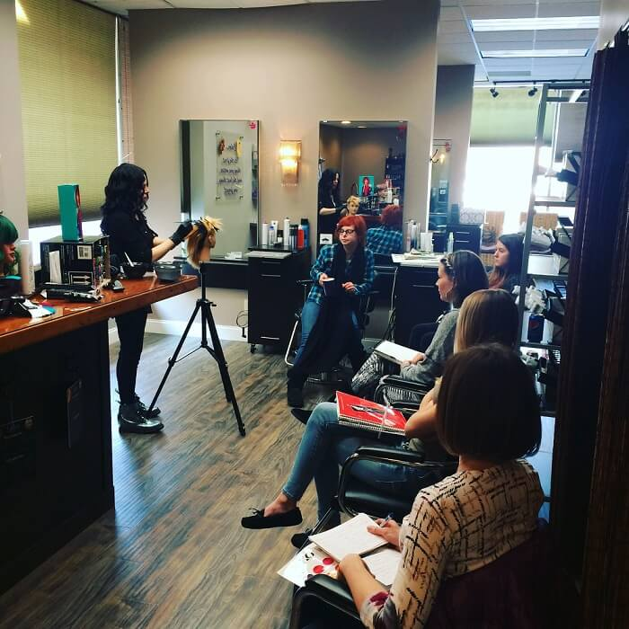Stylist practicing cut and color skills at The Colorist Salon in Cleveland