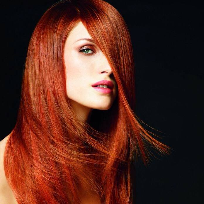 Woman with long layered red hair.