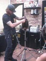 Paul Mitchell educator Zach teaching at The Colorist Bar and Salon